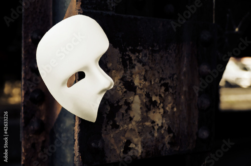 Fotografie, Obraz Masquerade - Phantom of the Opera Mask on Rusty Bridge Column