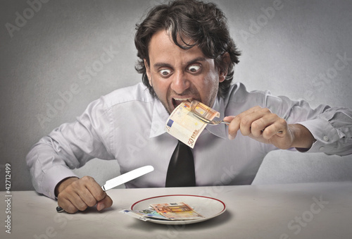 Fototapeta Greedy businessman
