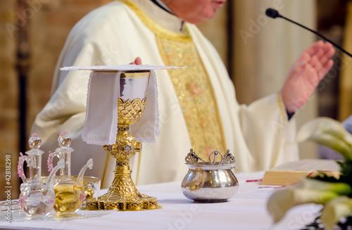 Fototapeta celebrating priest