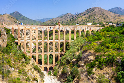 Fotografiet Old aqueduct in Nerja, Spain
