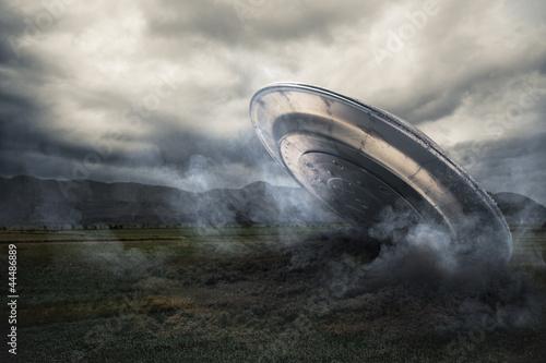 Canvas Print UFO crashing on a crop field