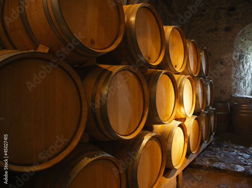 Canvas Print Wine barrels in a old wine cellar