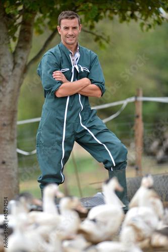 Obraz na plátně Duck breeder standing outside the farm