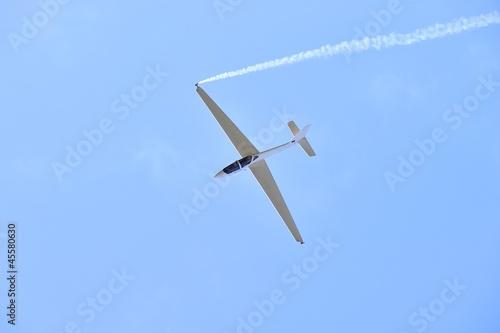 glider aerobatics with smoke