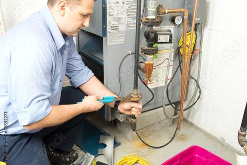 Wallpaper Mural Plumber repaires furnace
