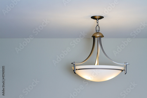 Photo Modern ceiling lamp in a new home