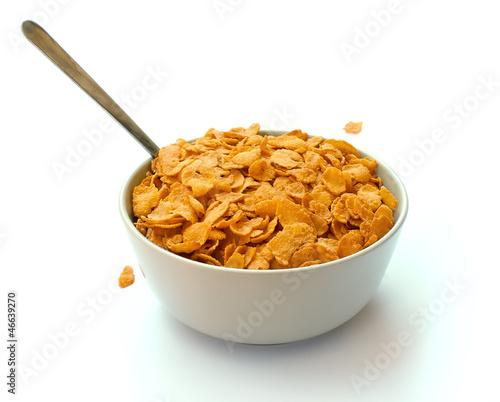 Fotografia, Obraz Bowl of corn flake cereal with a spoon