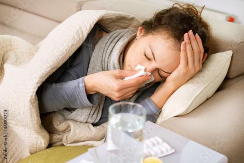 Carta da parati Sick Woman. Flu. Woman Caught Cold. Sneezing into Tissue
