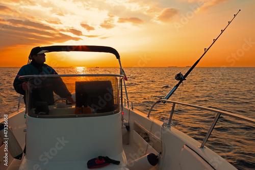 Fotografia, Obraz modern fishing boat at sunrise