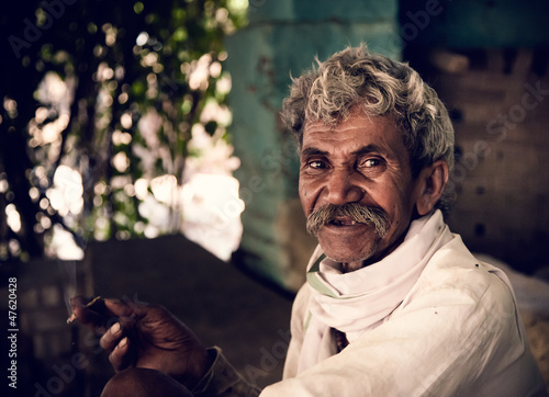 Smoking by old indian villager Fototapeta