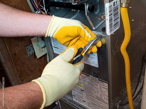Photo Hispanic air conditioning technician