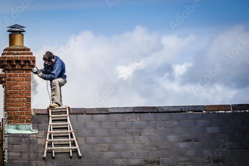 Billede på lærred Man on roof