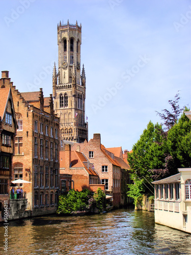 Vászonkép The famous Belfry and canal scene in Bruges, Belgium