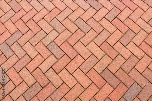 Wallpaper Mural Red brick paving stones on a sidewalk