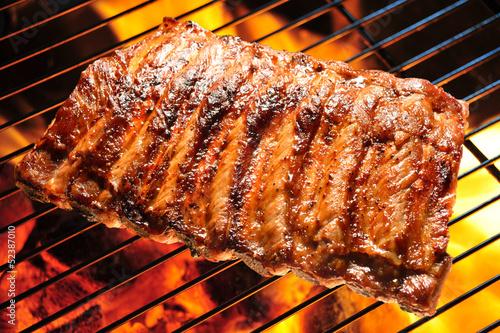 Obraz na plátně Grilled pork ribs on the grill.