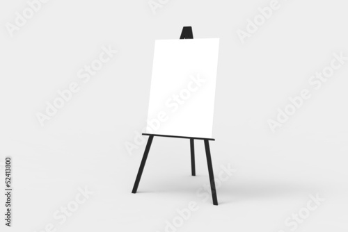 Photo A black easel with a blank white canvas on it.