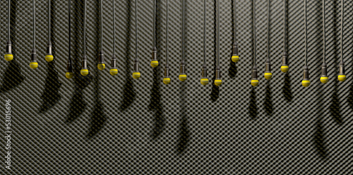 Microphones Dangling On Sound Proof Acoustic Foam