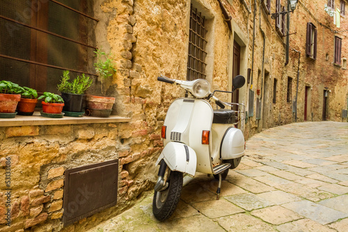 Canvas Print Old Vespa scooter on the street in Italy
