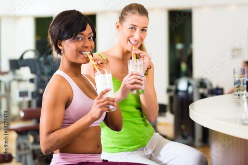 women in the gym drinking protein shake Fototapeta