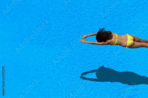 Stampa su Tela girl diving in the swimming pool