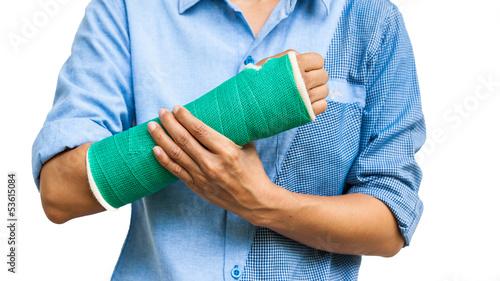 Obraz na plátne Green cast on an arm of a women isolated