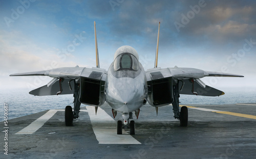 Photo F-14 jet fighter on an aircraft carrier deck viewed from front