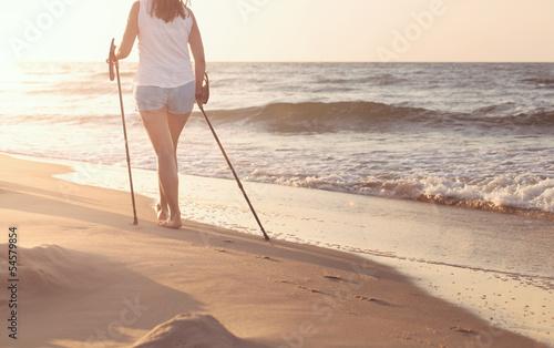 фотография Close up of female nordic walking on a beach