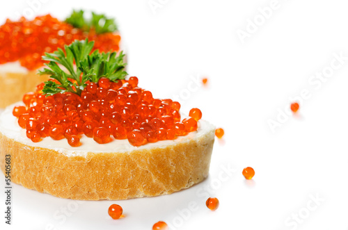 Red caviar with bread on white