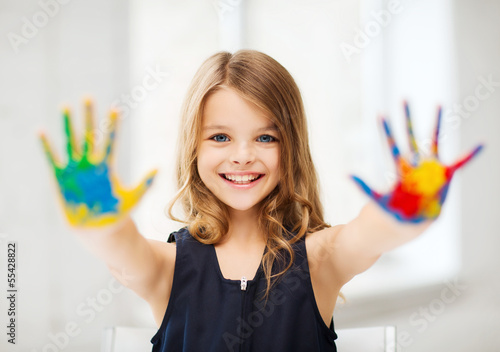 girl showing painted hands #55428822