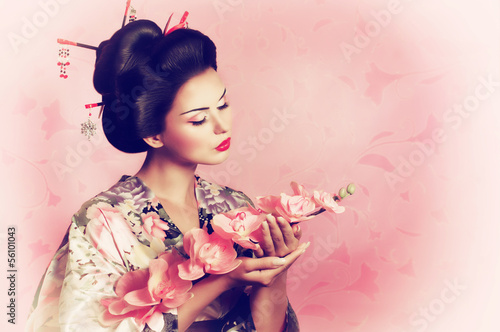 Valokuvatapetti Portrait of a Japanese geisha woman