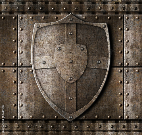 Leinwand Poster metal shield over armour background with rivets