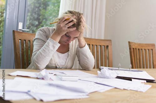 Fotografering Woman in debt