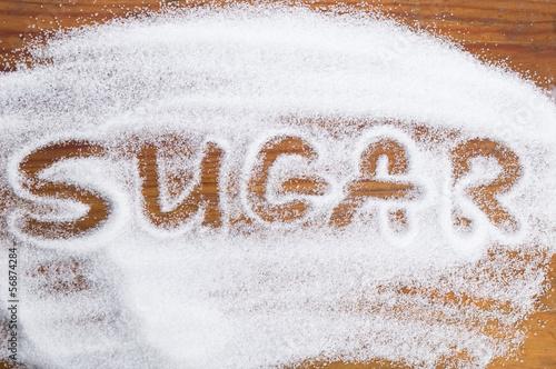 Fotografie, Obraz The word sugar written into a pile of white granulated sugar