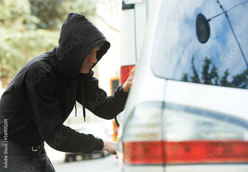 Wallpaper Mural thief burglar at automobile car stealing