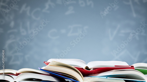 Canvas Print Open Textbooks with a Background of Formulas