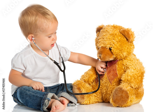 baby plays in doctor toy bear and stethoscope #57405466