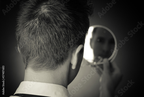Photo looking in the mirror and reflecting