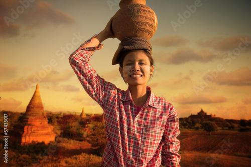 happy asian traditional farmer harvest at myanmar, bagan carryin фототапет