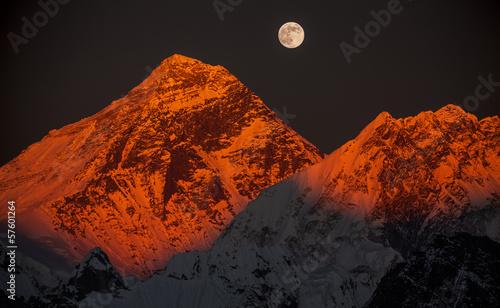 Peak Everest at sunset in a full moon.