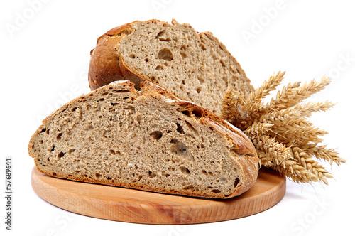 Two halves a loaf of rye bread and wheat ears. Tapéta, Fotótapéta