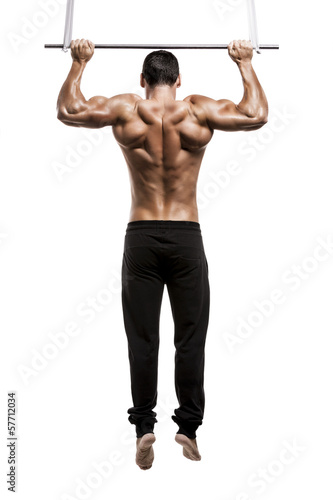 Muscle man in studio and showing the biceps muscle