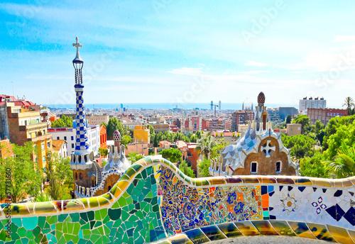 Fototapeta The Famous Summer Park Guell over bright blue sky in Barcelona