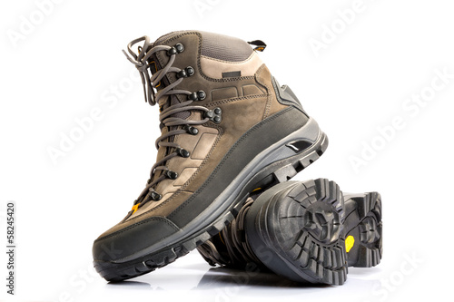 A pair of new hiking boots on white background Fototapet