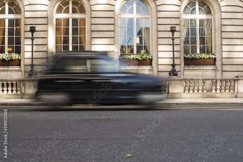 Vászonkép Taxi in motion in London