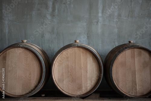 Cuadros en Lienzo Wine barrels stacked in the cellar of the winery