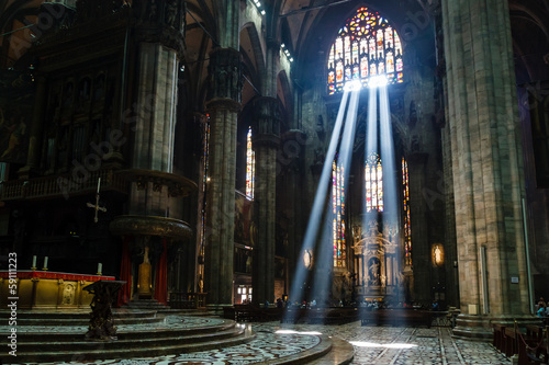 Wallpaper Mural The Bright Beam of Light Inside Milan Cathedral, Italy