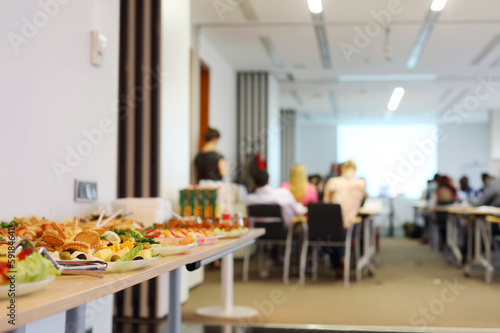 Table with cold snacks and refreshments for business meeting