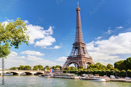 Fototapeta Eiffel tower in Paris, France. Panorama of Seine River in summer.