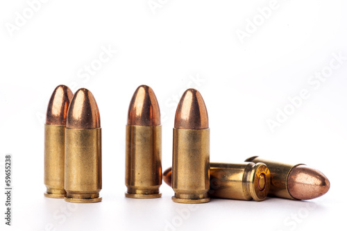 A group of 9mm bullets for a a gun isolated on white Fototapet