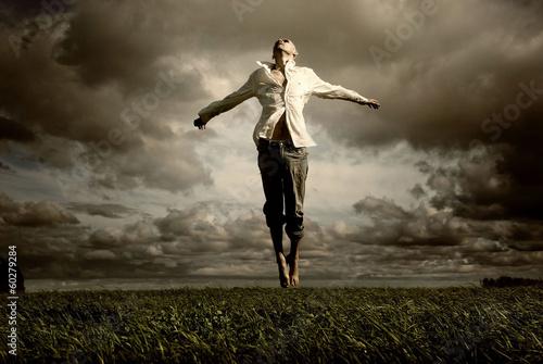 Valokuvatapetti man flying freedom yoga meditation